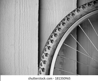 Abstract composition of a used mountain bike wheel in black and white