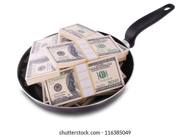 Abstract concept. Dollars in frying pan isolated on white with clipping path.