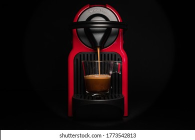 Abstract and conceptual of home coffee nespresso machine. isolated on black background. Coffee machine with cup of coffee and foam. Graphic resources with copy space.