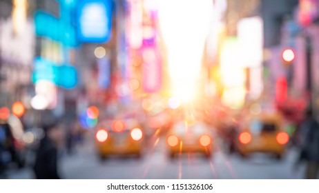 Abstract and conceptual photo o New York city at Times Square at sunset.