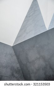 Abstract concrete wall. interior with chaotic polygonal relief pattern on the wall