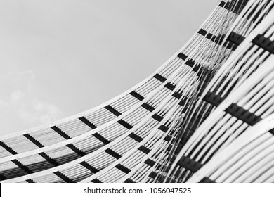 Abstract construction details of a modern skyscraper facade made of glass and steel