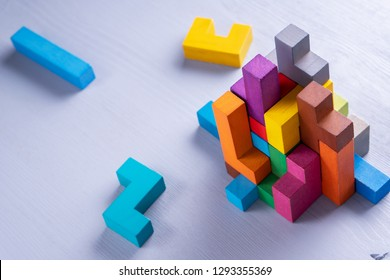 Abstract construction from wooden blocks shapes. The concept of logical thinking, geometric shapes.