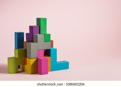 Abstract construction from wooden blocks tetris shapes. The concept of logical thinking, geometric shapes.
