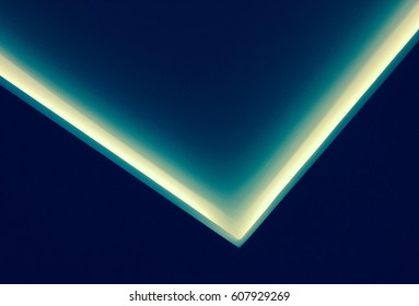 Abstract contemporary architecture background, ceiling lighting corner, neon light stripe over dark blue
