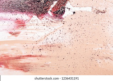 Abstract cosmetic background made of liquid foundation, lipstick and glitter. Make-up concept