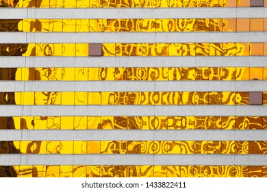 Abstract created by Golden yellow reflections on modern building windows