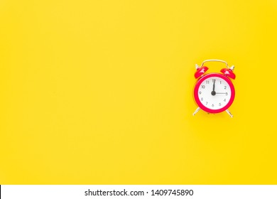Abstract creative flat lay vintage yellow table top view office background concept red clock on paper color in minimal, Hot summer holiday time to break workplace at noon for lunch, Retro Hipster
