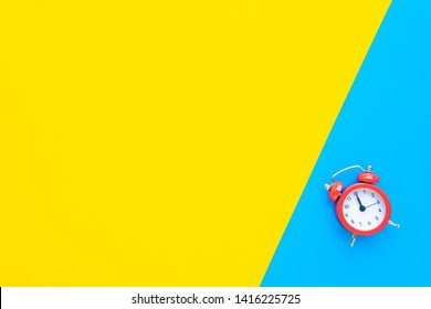 Abstract creative flat lay vintage yellow blue table top view office background concept red clock on paper color in minimal style, Hot summer holiday time to break workplace at noon for lunch, Retro