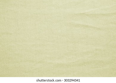 Abstract crumpled olive green colors fabric texture background.