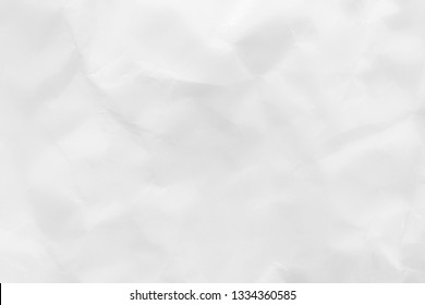 Abstract Crumpled white paper background. Paper texture wallpaper.