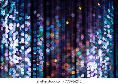 Abstract crystal balls hanging on nylon strings, selective focus