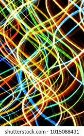 Abstract curve motion neon color lights on black backgrounds.