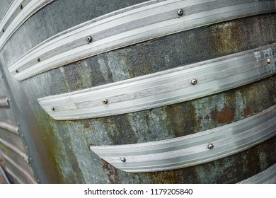 abstract of curved metal strips on an old hosebox trailer