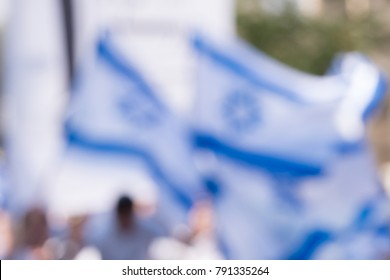 abstract of dance with the Israeli flags during the Jerusalem day (Israeli national holiday commemorating the reunification of Jerusalem) in a street of Jerusalem