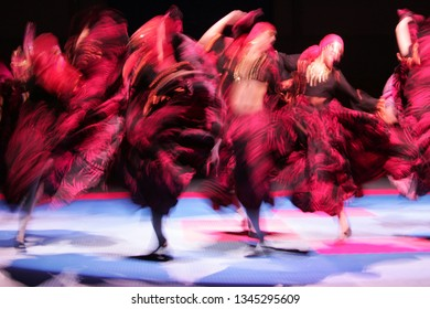 Abstract dancer on the move, in various spotlights