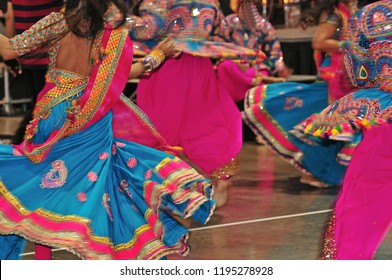 Abstract of dancing people colourful costume with motion effect during navratri festival celebration. Navratri is a Hindu festival, dedicated to the worship of Goddess Durga and her divine avatars.