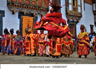 Abstract dancing,Bhutan dance is tradition tibet.Traditional dance and colors in Mongar, Bhutan,A monk in a colorful dress with mask during the tsechu (dance festival),mask festival