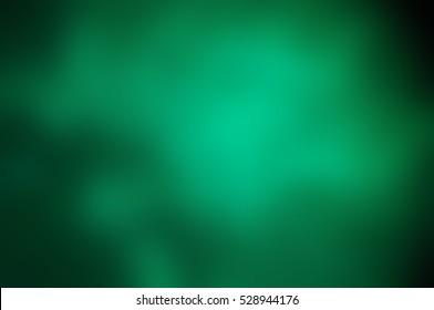 Abstract dark background, green smoke in the dark