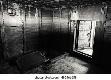 Abstract dark grungy industrial interior with metal walls and open heavy steel door