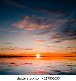 abstract dark nature background with sea red sunrise and clouds