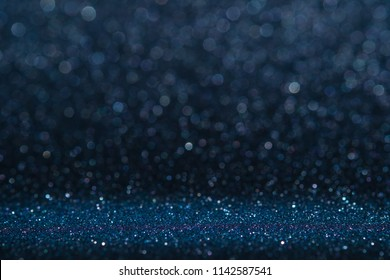 Abstract dark navy blue sparkling glitter wall and floor perspective background studio with blur bokeh.luxury holiday backdrop mock up for display of product.holiday festive greeting card