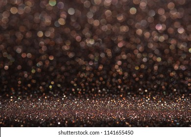 Abstract dark orange brown sparkling glitter wall and floor perspective background studio with blur bokeh.luxury holiday backdrop mock up for display of product.holiday festive greeting card