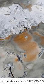 Abstract Dark Orange, Dark Gray, and White Natural Rocky Spring