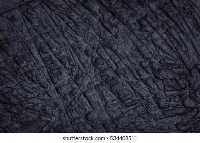 Abstract dark stone texture.