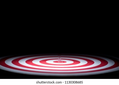 abstract dartboard on dark background lighted with snoot