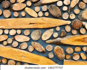 Abstract decorative pieces of teak wood  on gray background