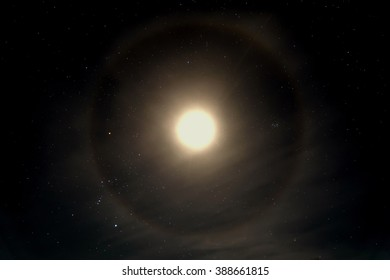 Abstract decorative space background with stars and moon halo on the dark night sky