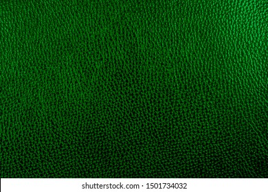 Abstract deep green artificial leather pattern.  Dark green leatherette for texture background.  top view.  Light and shadow.