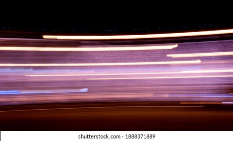 Abstract defocus motion curved lights on dark background