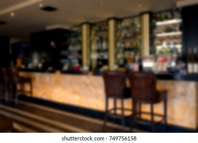 Abstract defocused with blur and bokeh in coffee shop cafe and restaurant interior for background