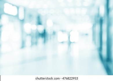 abstract defocused blurred background, empty business corridor or shopping mall. Medical and hospital corridor defocused background with modern laboratory (clinic)