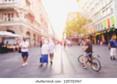 abstract defocused blurred background with silhouettes of unrecognizable people