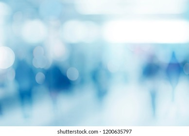 abstract defocused blurred empty space technology background with silhouettes of unrecognizable people