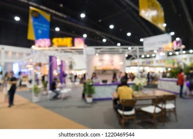 Abstract defocused blurred of people in public trade show expo event at modern exhibition hall background. MICE industrial business concept.