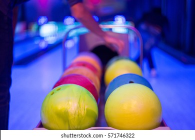 Abstract defocused motion on bowling ball in rail in motion blacklight