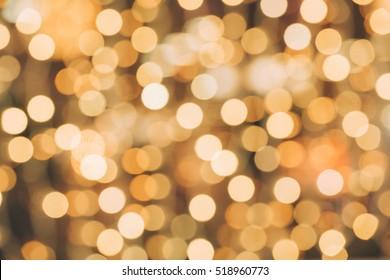 Abstract defocused orange sparkles background