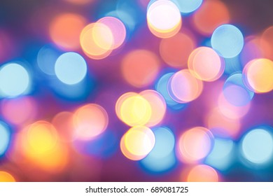 Abstract defocused Teal and Orange with white background. Teal Turquoise Azure and Amber color background. Rainbow Wallpaper. Soft blur orange and blue background. Defocused LED light.