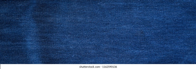 Abstract denim jeans fabric texture for background website fashion design or backdrop product.
