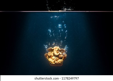 An abstract depiction of Lord Ganesha during immersion in a water body as part of the annual ritual during Ganesha Chathurthi Hindu festival