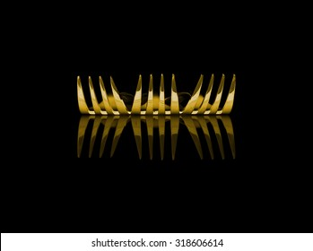 Abstract design of shiny gold metal fork utensils on clean black background.