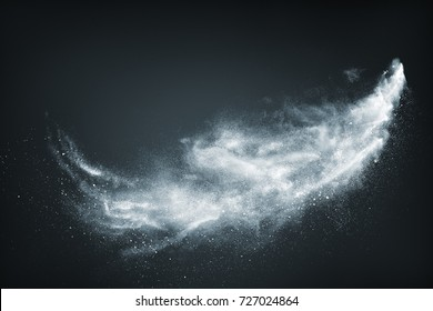 Abstract design of white powder snow cloud explosion on dark background