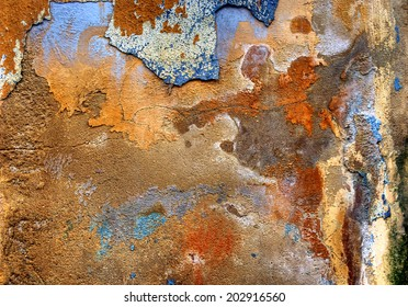 Abstract detail from a plastered wall, in which you can discover several figures. This phenomena is called apophenia.