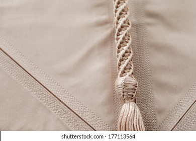 An abstract detail of a Tarboosh which is an Arabic style (tassel like) tie that is usually worn with a thawb or kandura in Arabia.