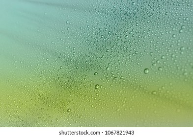 Abstract detail of water drops and rays of light.