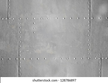 Abstract detailed gray metal wall background texture with seams and rivets
